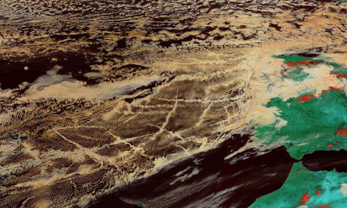 "Near-infra-red wavelengths pick out ""ship tracks,"" clouds formed by ship exhausts, off the coast of Spain."